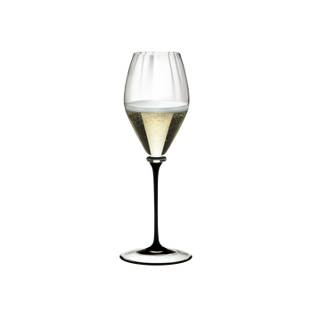 RIEDEL Fatto A Mano Performance Champagne Glass Black Stem filled with a drink on a white background
