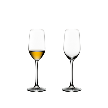 RIEDEL Ouverture Tequila filled with a drink on a white background