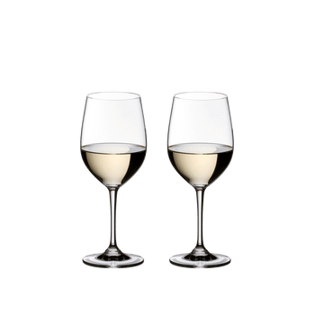 2 RIEDEL Vinum Viognier/Chardonnay glasses filled with white wine standing side by side