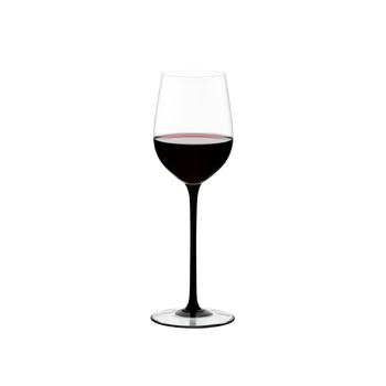RIEDEL Sommeliers Black Tie Mature Bordeaux filled with a drink on a white background