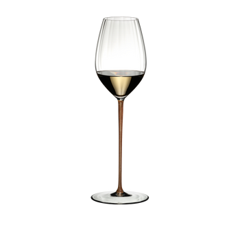 RIEDEL High Performance Riesling Gold filled with a drink on a white background