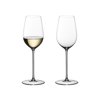 Two RIEDEL Superleggero Riesling/Zinfandel glasses stand side by side on white background. The glass on the left side is filled with white wine, the other one is empty.
