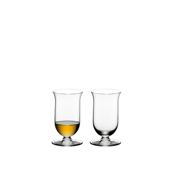 Two RIEDEL Vinum Single Malt Whisky glasses side by side. The glass on the left side is filled with whisky, the other one is empty.