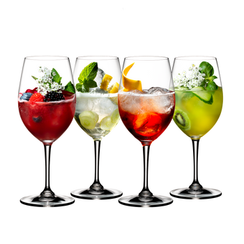 4 different decorated cocktails served in RIEDEL Spritz Drinks glasses standing slightly offset side by side