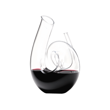 RIEDEL Decanter Curly Clear filled with a drink on a white background