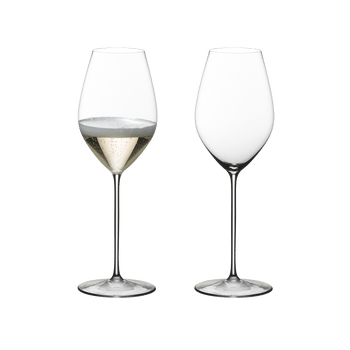 A Champagne filled and an unfilled RIEDEL Superleggero Champagne Wine Glass stand side by side