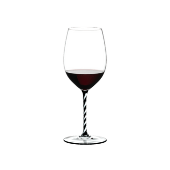 RIEDEL Fatto A Mano Cabernet/Merlot Black & White R.Q. filled with a drink on a white background