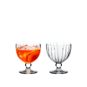 RIEDEL Sunshine Coupette filled with a drink on a white background