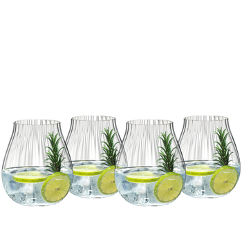 4 decorated gin cocktails served in RIEDEL Tumbler Collection Optical O Gin glasses stand slightly offset side by side