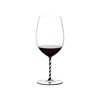 RIEDEL Fatto A Mano Bordeaux Grand Cru Black & White R.Q. filled with a drink on a white background