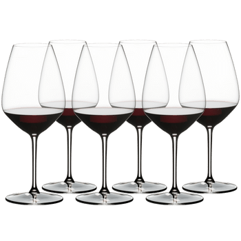 RIEDEL EXTREME SHIRAZ filled with a drink on a white background