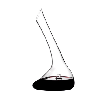 RIEDEL Decanter Flirt filled with a drink on a white background