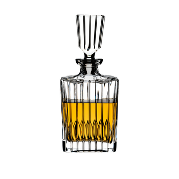RIEDEL Drink Specific Glassware Spirits Decanter filled with a drink on a white background