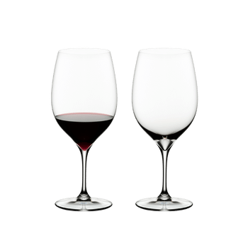 RIEDEL Grape@RIEDEL Cabernet/Merlot filled with a drink on a white background