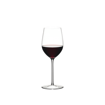 RIEDEL Sommeliers Mature Bordeaux/Chablis/Chardonnay filled with a drink on a white background