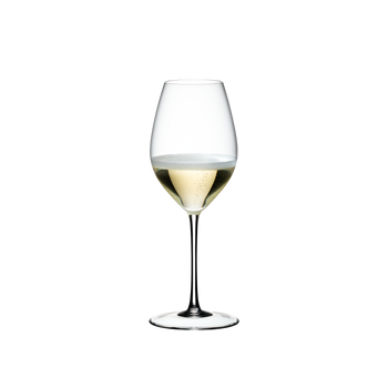 RIEDEL Sommeliers Champagne Wine Glass filled with a drink on a white background