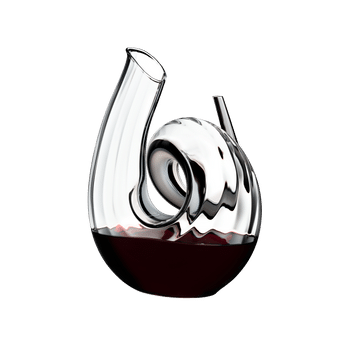 RIEDEL Decanter Curly Fatto A Mano filled with a drink on a white background