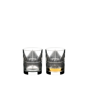 RIEDEL Tumbler Collection Shadows filled with a drink on a white background