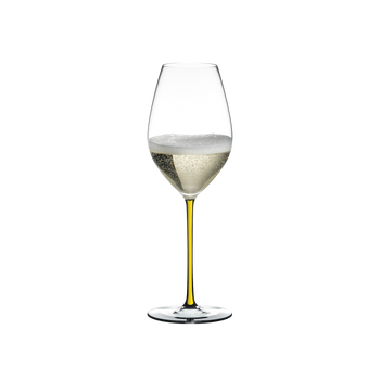 RIEDEL Fatto A Mano Champagne Wine Glass Yellow R.Q. filled with a drink on a white background
