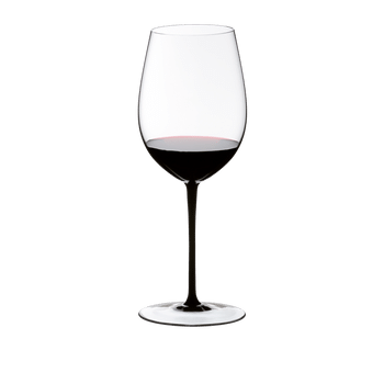 A RIEDEL Sommeliers Black Tie Bordeaux Grand Cru filled with red wine