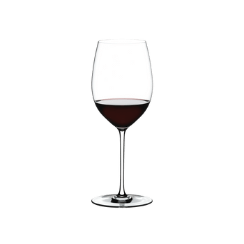 RIEDEL Fatto A Mano Cabernet/Merlot White R.Q. filled with a drink on a white background