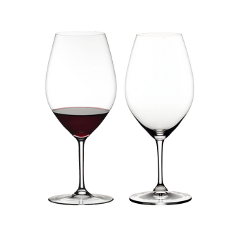 RIEDEL Ouverture Double Magnum filled with a drink on a white background