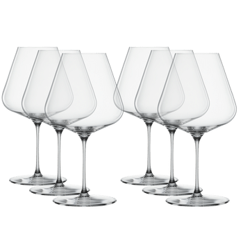6 unfilled SPIEGELAU Definition Burgundy glasses stand in two rows slightly offset side by side