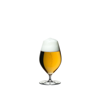 RIEDEL Veritas Beer filled with a drink on a white background