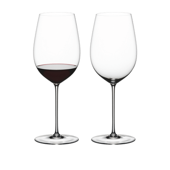 Two RIEDEL Superleggero Bordeaux Grand Cru glasses side by side. The wine glass on the left is filled with red wine, the other one is empty.