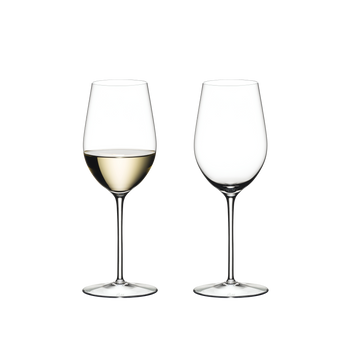 Two RIEDEL Sommeliers Riesling Grand Cru/Zinfandel glasses side by side on white background. The wine glass on the left side is filled with white wine, the other one is empty.