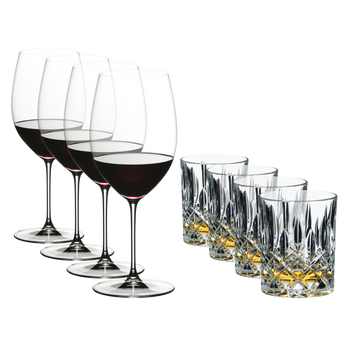 4 red wine filled RIEDEL Veritas Cabernet Sauvignon glasses and 4 Tumbler Collection Spey Whisky filled with Wkisky.