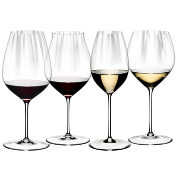 RIEDEL Performance Tasting Set filled with a drink on a white background