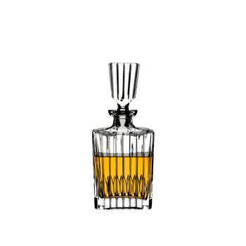 A RIEDEL Drink Specific Glassware Spirits Decanter filled with a golden brown liquor