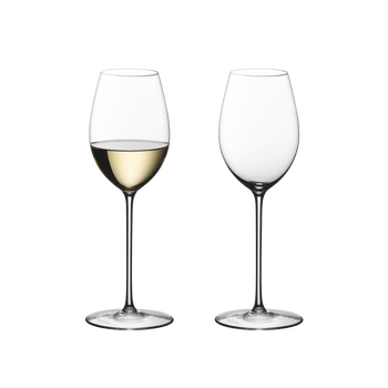 Two RIEDEL Superleggero Loire glasses side by side. The wine glass on the left side is filled with white wine, the other one is empty