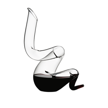 RIEDEL Decanter Boa filled with a drink on a white background
