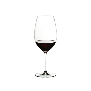 RIEDEL Veritas New World Shiraz filled with a drink on a white background