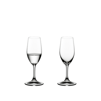 RIEDEL Ouverture Spirits filled with a drink on a white background
