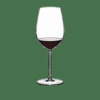 A RIEDEL Superleggero Bordeaux Grand Cru glass filled with red wine