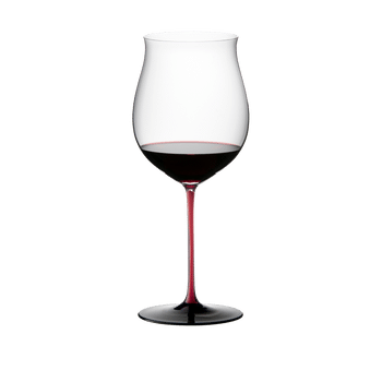 RIEDEL Black Series Collector's Edition Burgundy Grand Cru filled with a drink on a white background