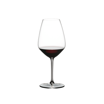 RIEDEL Extreme Restaurant Shiraz filled with a drink on a white background
