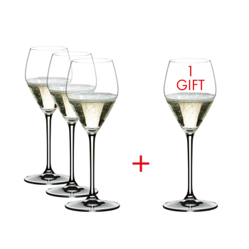 4 RIEDEL Heart To Heart Champagne Glasses filled with Champagne on white background