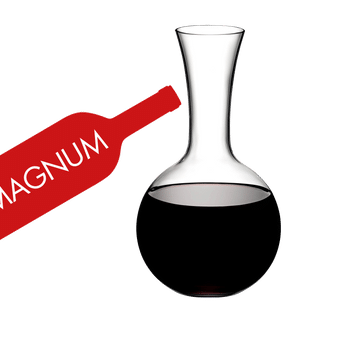 RIEDEL Decanter Syrah Magnum filled with a drink on a white background
