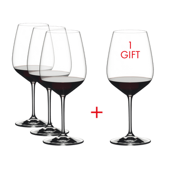RIEDEL Heart To Heart Cabernet Sauvignon filled with a drink on a white background
