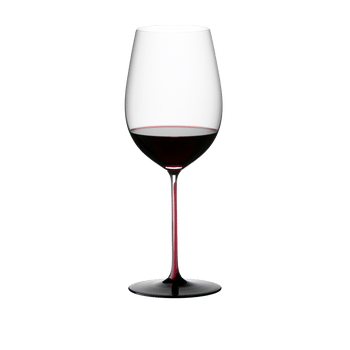 RIEDEL Black Series Collector's Edition Bordeaux Grand Cru filled with a drink on a white background