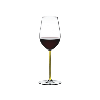 RIEDEL Fatto A Mano Riesling/Zinfandel Yellow filled with a drink on a white background