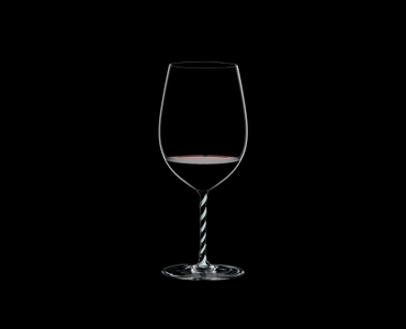 RIEDEL Fatto A Mano Bordeaux Grand Cru Black & White filled with a drink on a black background