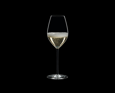 RIEDEL Fatto A Mano Champagne Wine Glass Black filled with a drink on a black background