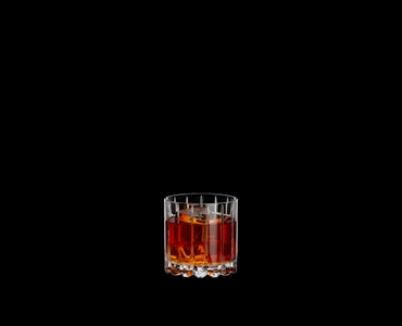 RIEDEL Drink Specific Glassware Rocks filled with a drink on a black background