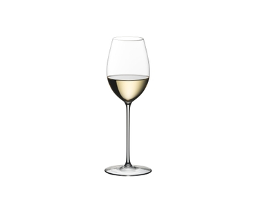 Blonde woman in a white summer dress with a white wine filled RIEDEL Superleggero Loire glass in her hand