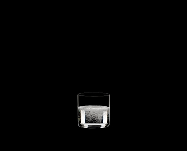 RIEDEL Bar Water filled with a drink on a black background